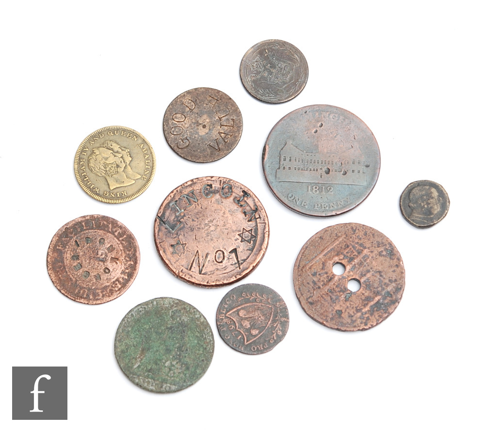 A collection of 19th Century copper work tokens some with overstamps.