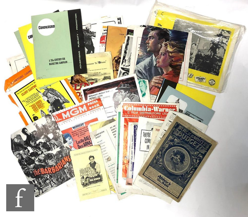 A collection of various cinema campaign books, some complete and some part complete, films to