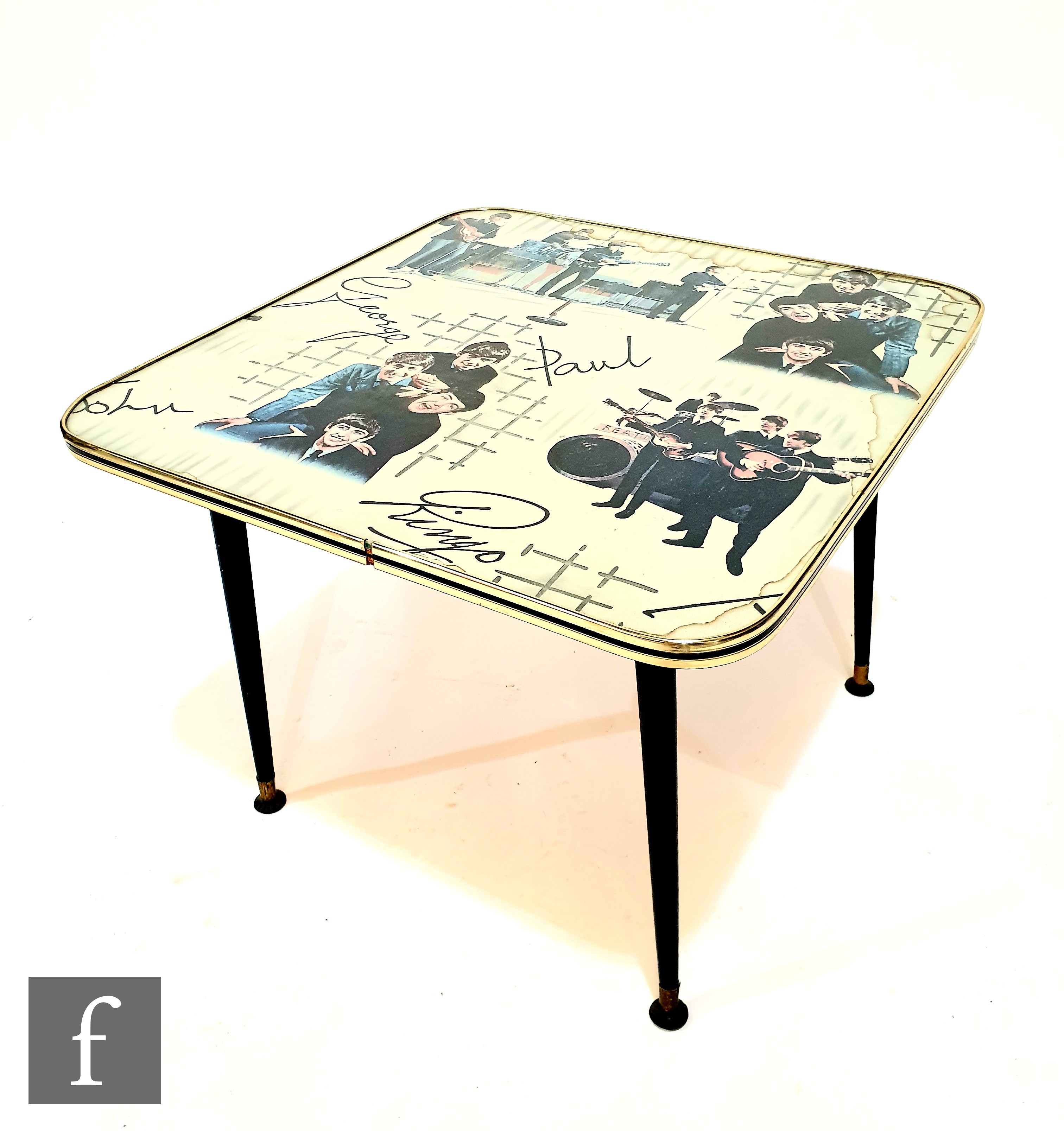 An original 1960s Beatles table, the splayed black legs with gilt edged plastic square top with