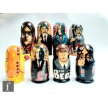 A collection of Russian John Lennon and The Beatles matryoshka/nesting dolls, comprising seven