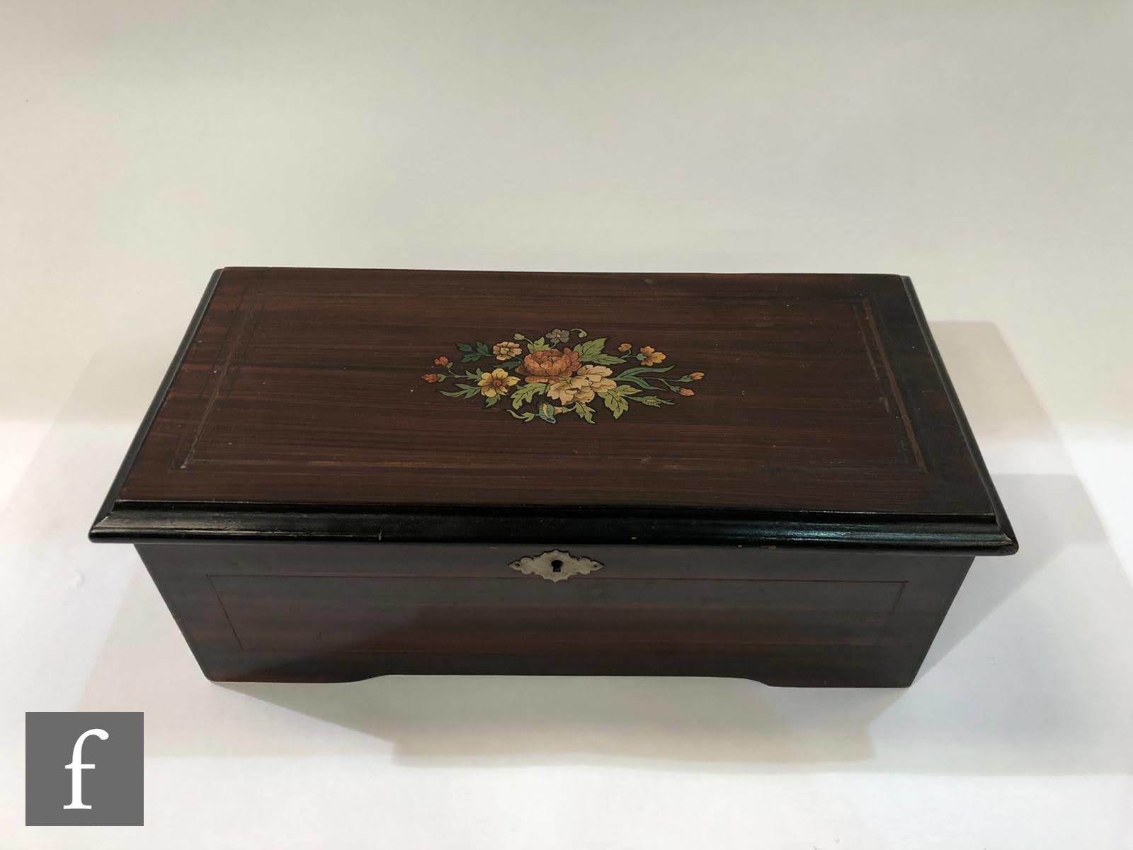 A musical box, serial No 16838, playing six airs, printed tune card, simulated rosewood case with