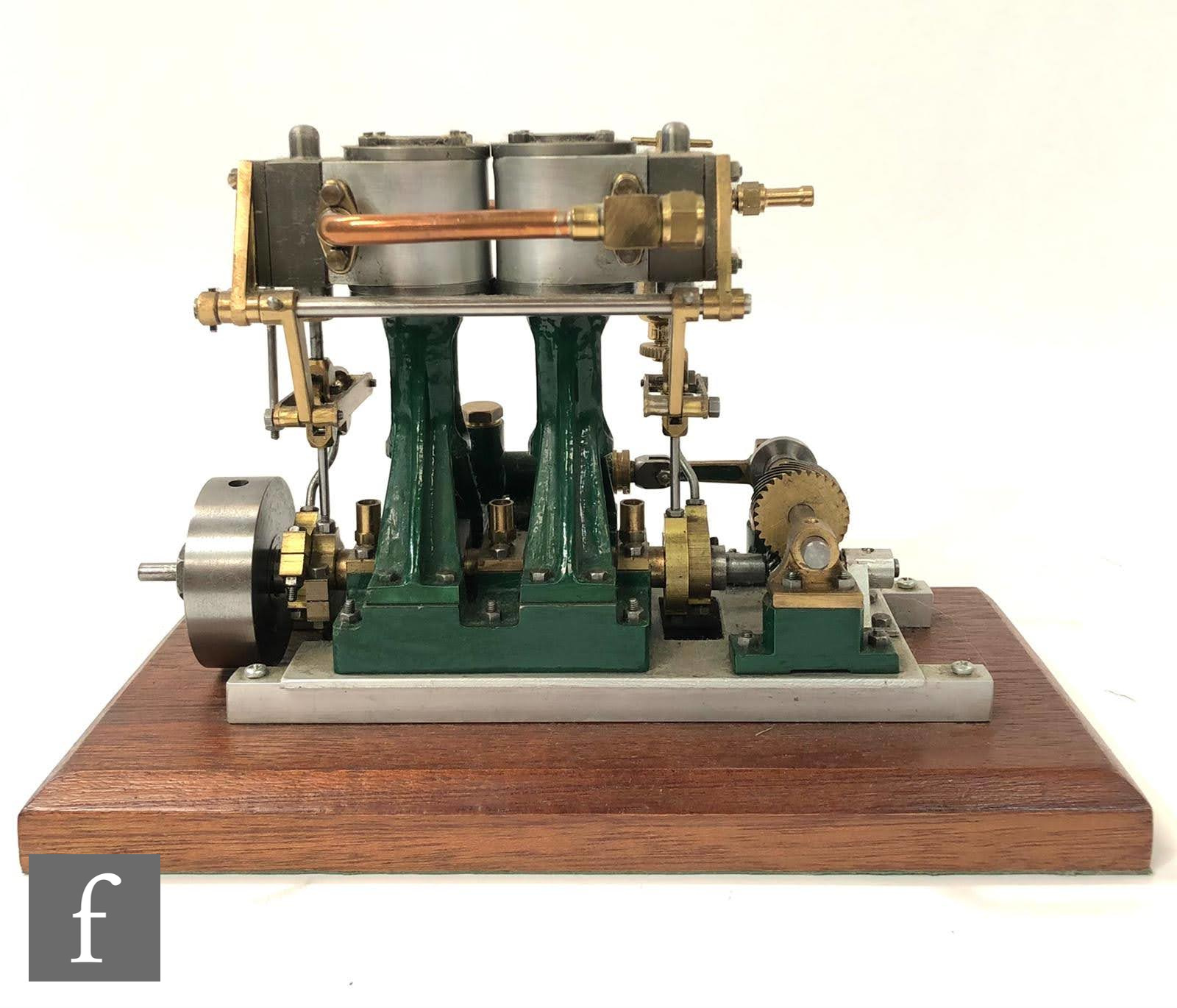 A Stuart twin cylinder marine engine with bevel gear drive and vertical oscillating pistons, painted