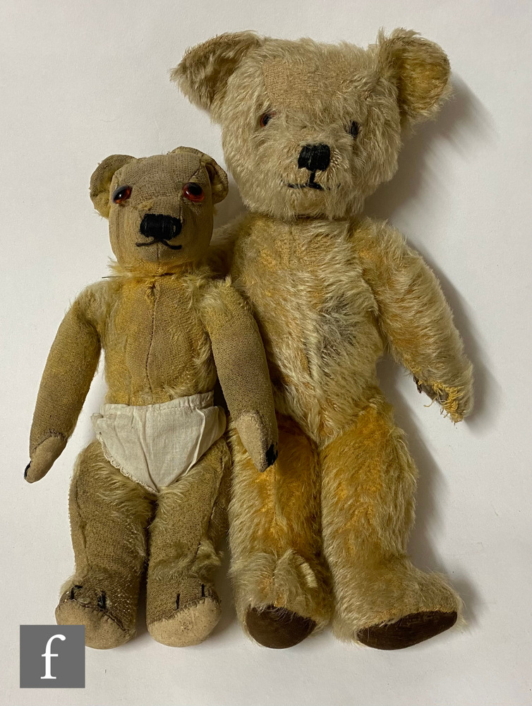 A mid 20th Century Merrythought teddy bear, golden mohair with amber and black eyes, vertically