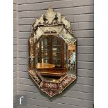 A Venetian style octagonal wall mirror, the panelled border etched with a floral design mounted with