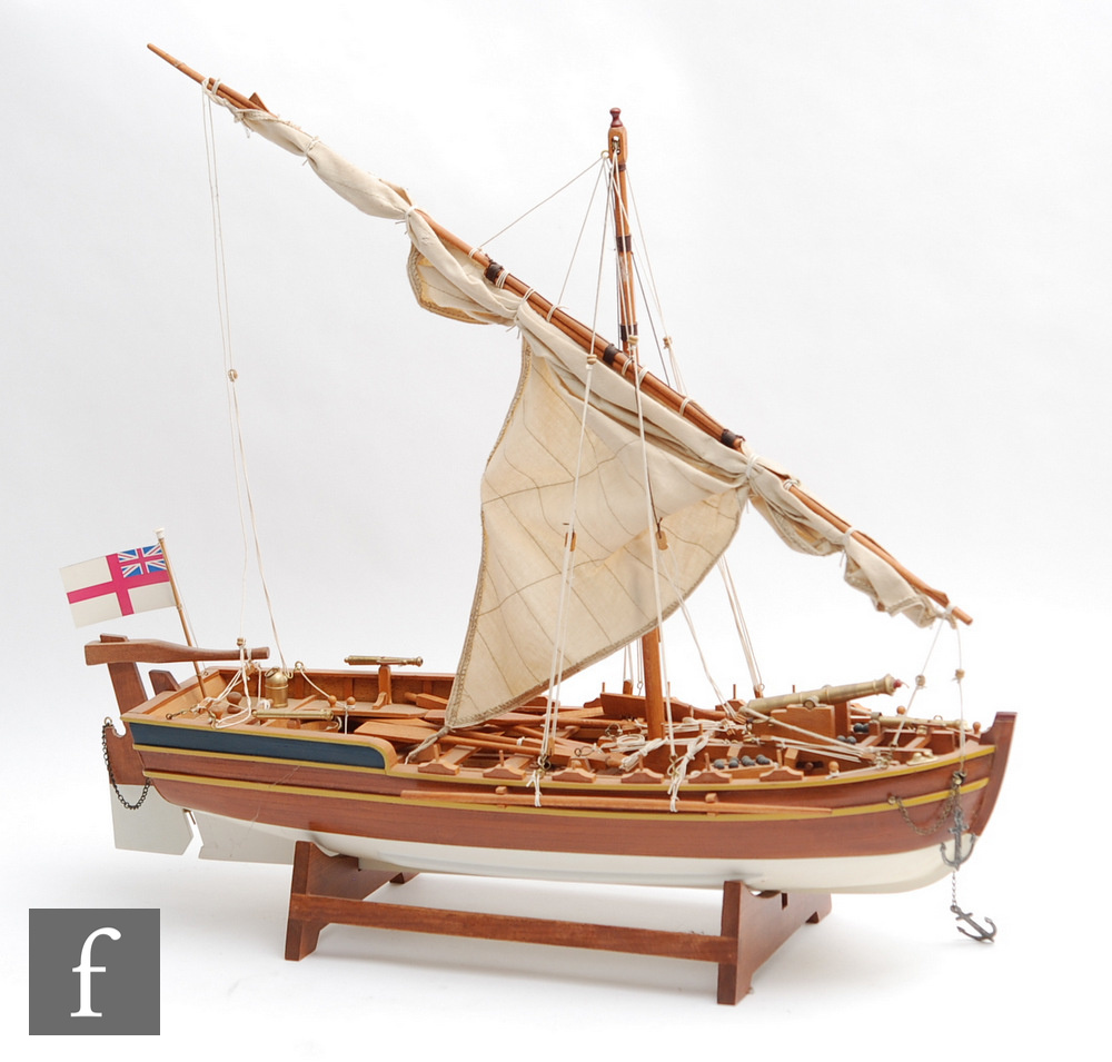 A 20th Century wooden scale model of a single master sloop fitted with a single brass canon and