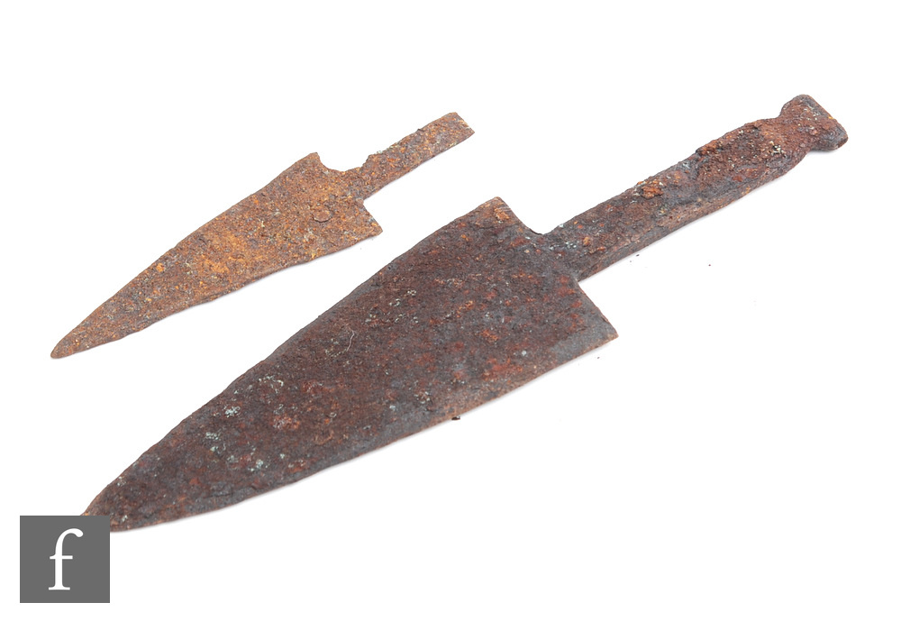 Two possible Celtic Iberian iron daggers, each missing its hilt, 29cm the smaller 17cm. (2)