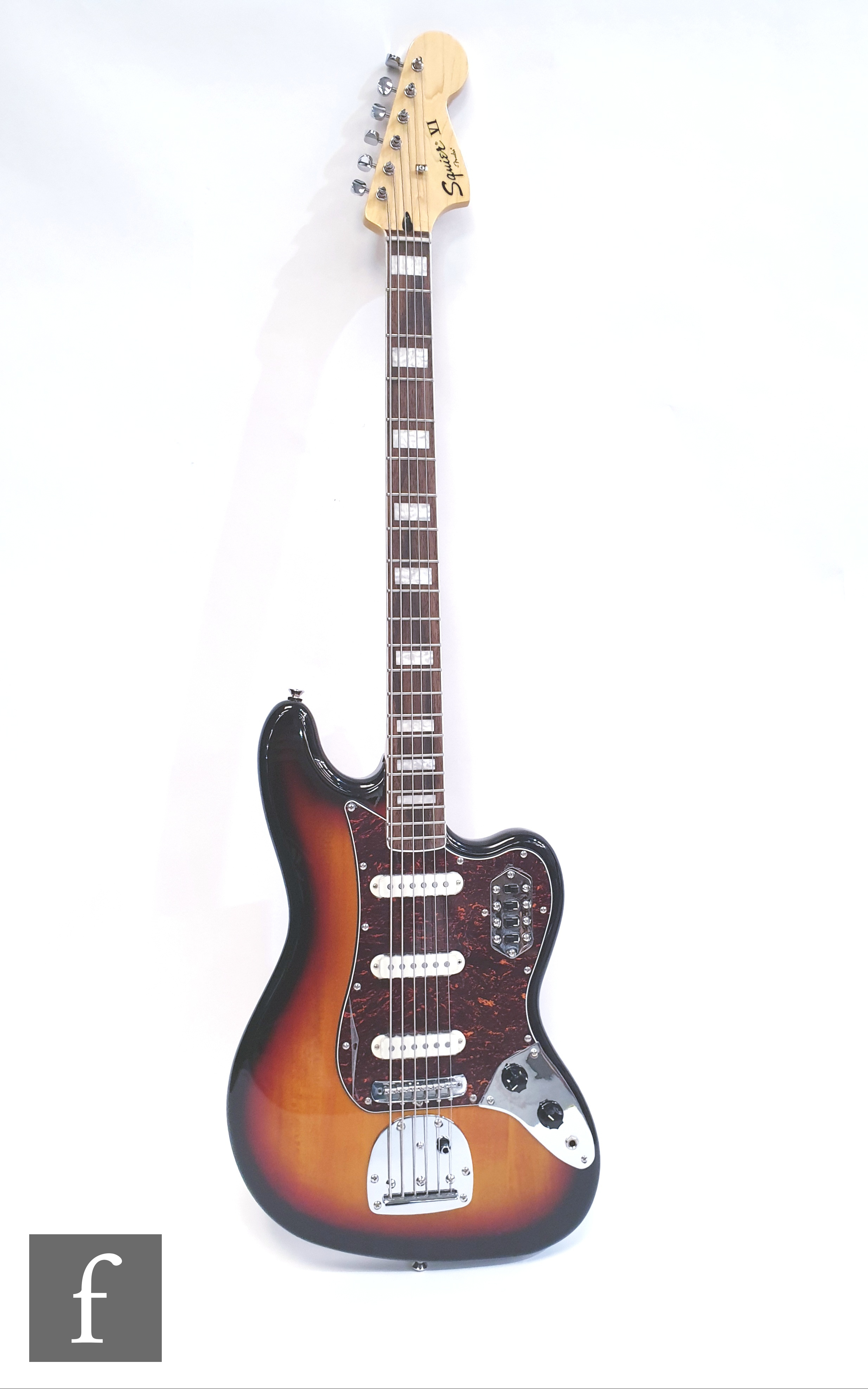 A Squire VI by Fender electric guitar, serial number 15208800, made in Indonesia, sunburst finish,