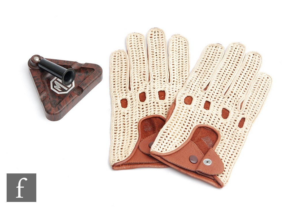 A pair of MG leather driving gloves and a brown Bakelite ashtray with fixed pen holder. (2)