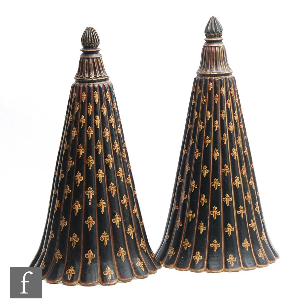 A pair of painted wooden wall lights, the scalloped and tapered lights painted in black and red with
