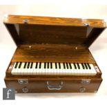 A Pearl River pedal operated organ/harmonium in oak case, width 79cm.