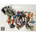 A collection of 1980s and 1990s action figures, to include LJN Thundercats including the Thundertank