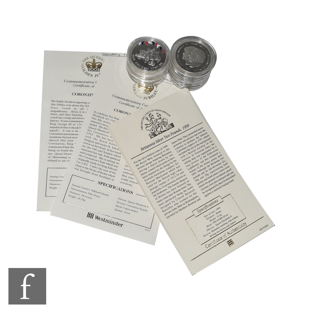 An Elizabeth II five pound and a two pound commemorative silver proof coins with certificates and