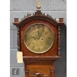 A Regency style mahogany longcase clock with an associated eight-day movement striking on a bell,