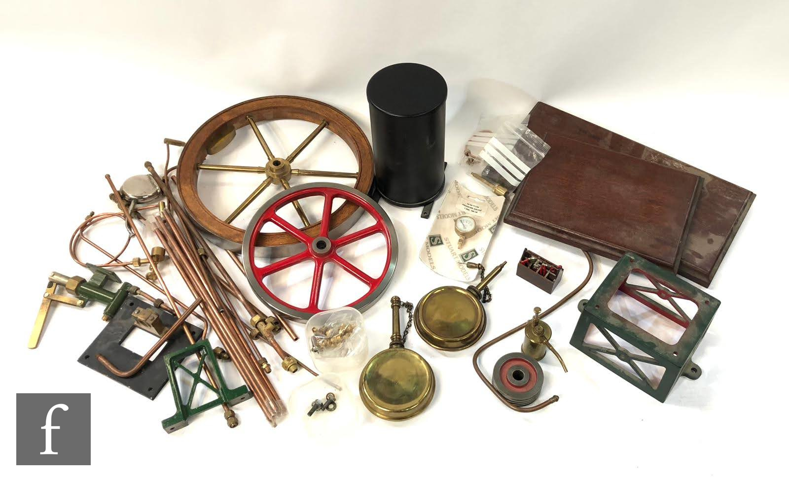 A selection of various components for live steam modelling, to include copper rods, six spoked