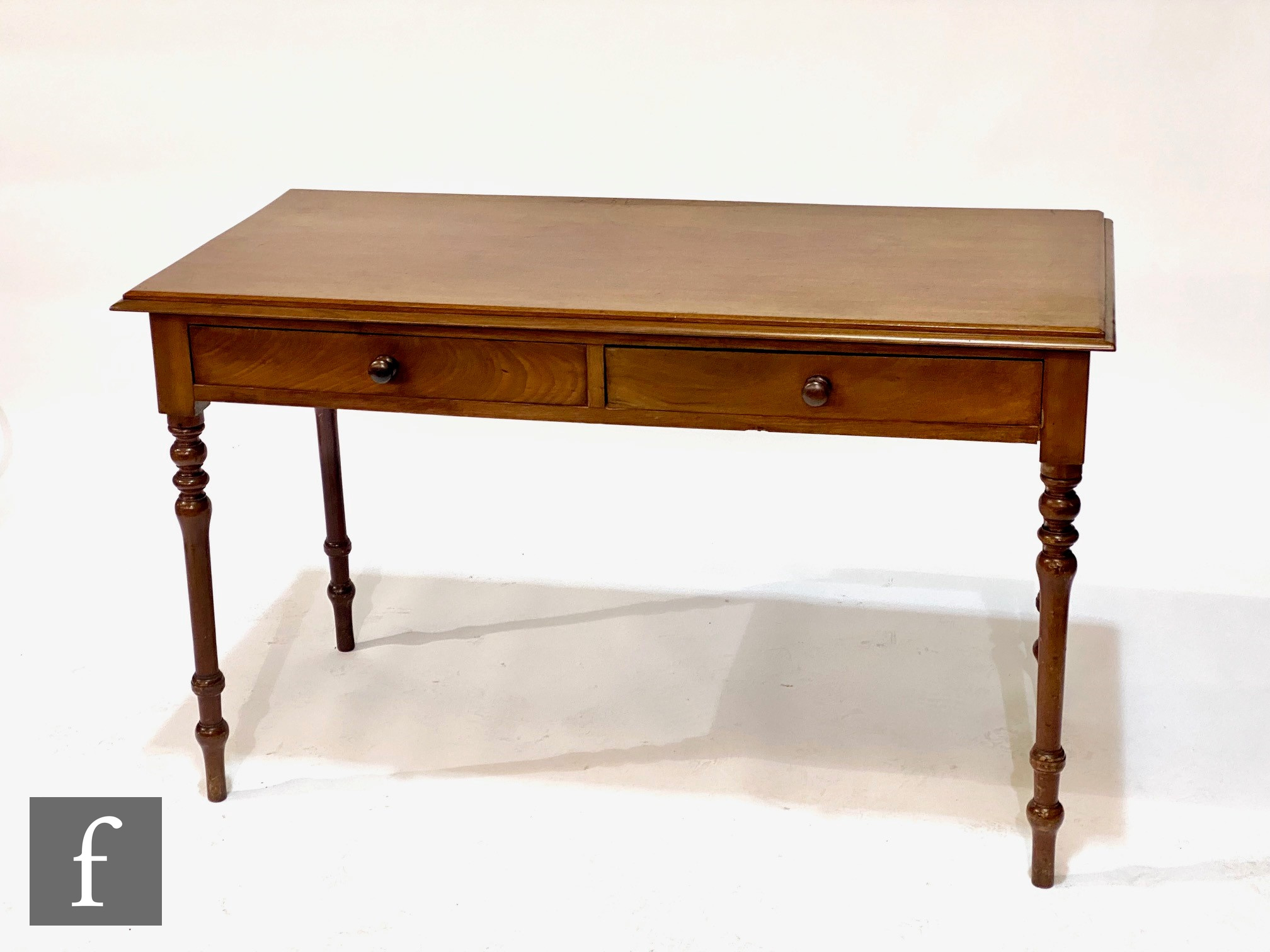 A late 19th to early 20th Century mahogany side table, fitted with two frieze drawers above turned