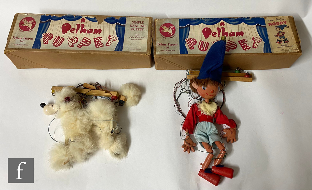 Two Pelham Puppets, an SL Noddy in buff box with Enid Blyton's Noddy picture label, and Poodle in