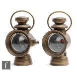 A pair of early 20th Century brass car lamps by Powell & Hanmer Ltd, Birmingham, height 33cm. (2)