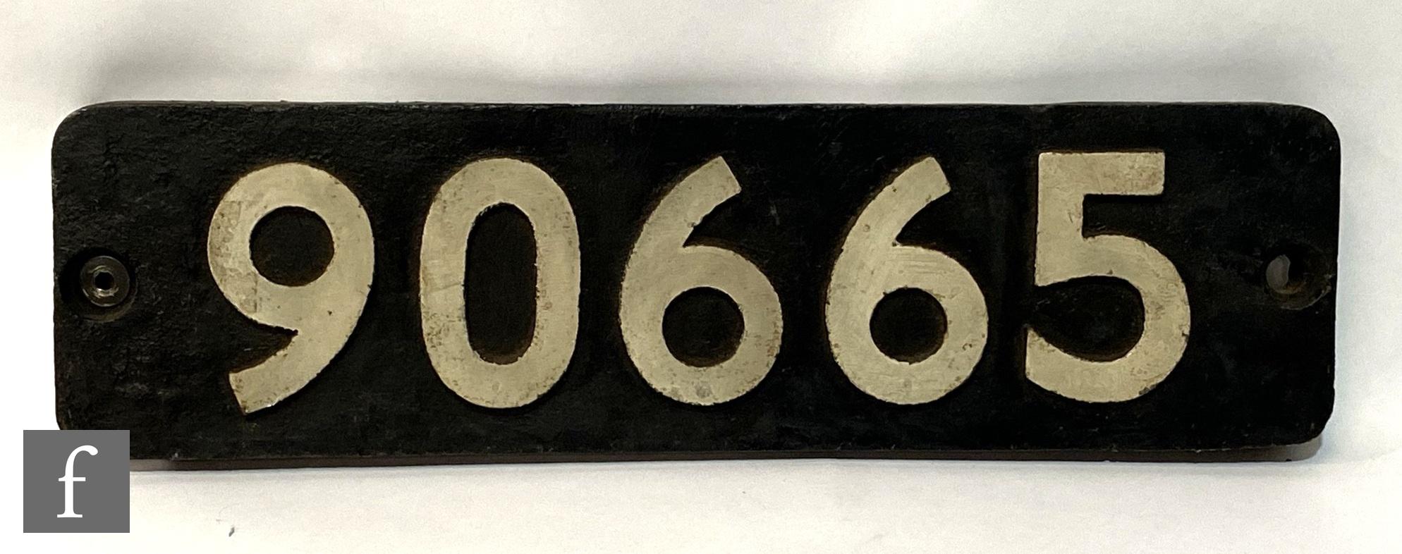 A cast iron locomotive smoke box No 90665, white lettering on a black background, 55cm x 15cm.