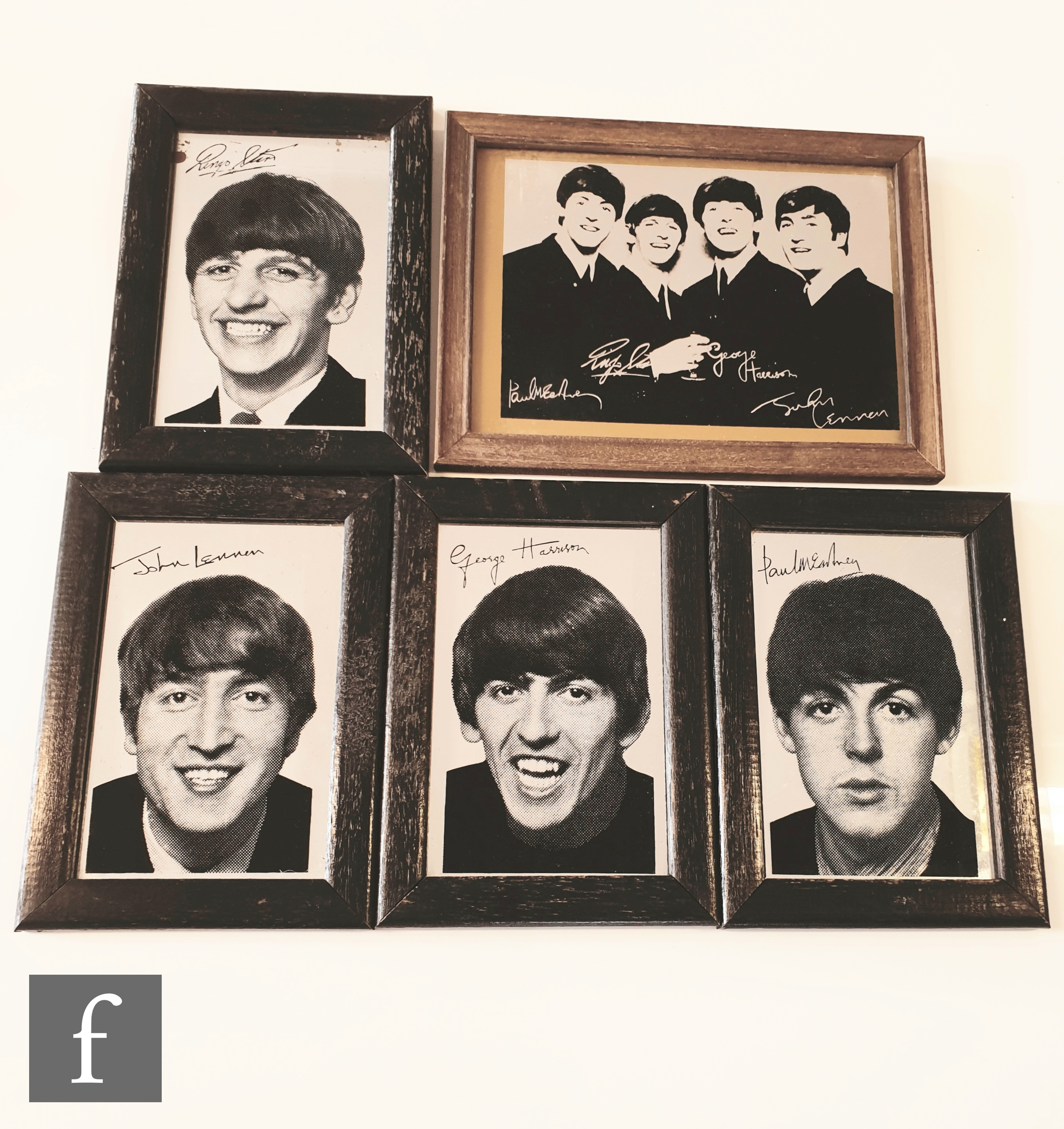 A group of four framed mirrors each printed with a portrait of John Lennon, Paul McCartney, George