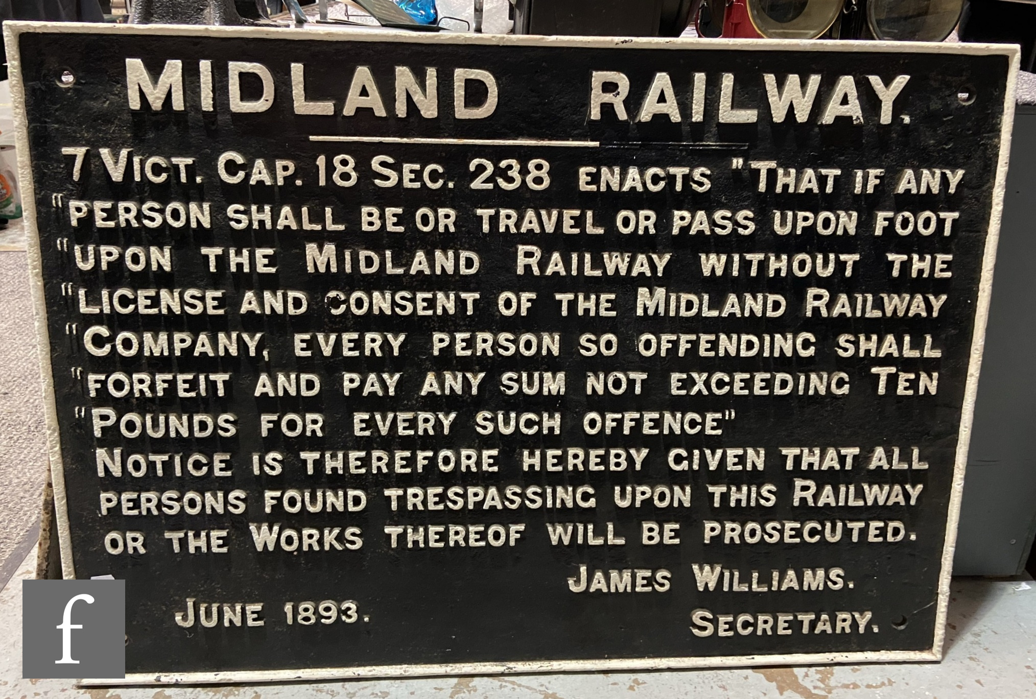 A cast iron Midland Railway sign for license and consent to travel and pass, dated June 1893, 71cm x