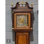 An 18th Century oak and mahogany cross-banded longcase clock with a thirty-hour movement striking on