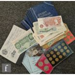 A 1949 five pound banknote, serial no 65 008506 cashier P S.Beale, a Britannia one pound note, a ten