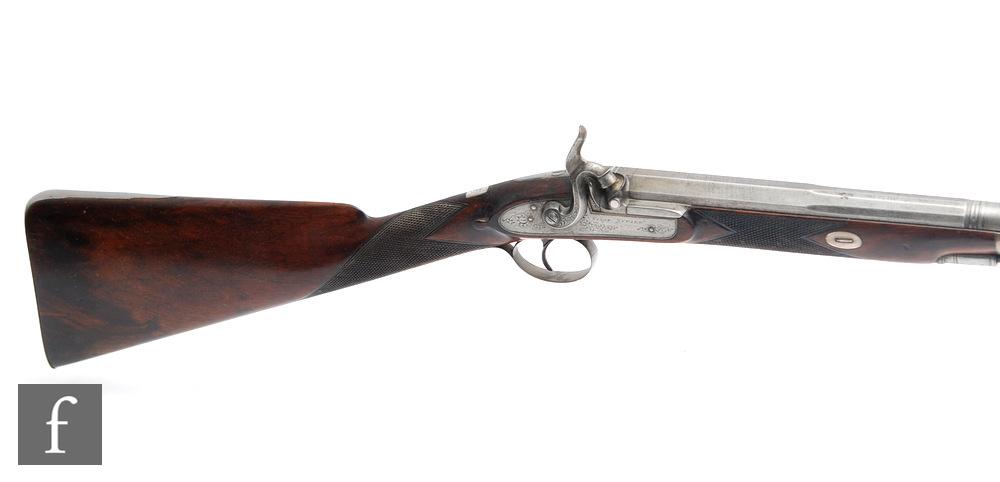 A 19th Century percussion musket, engraved side lock stamped Nixon Newark with ramrod, plain