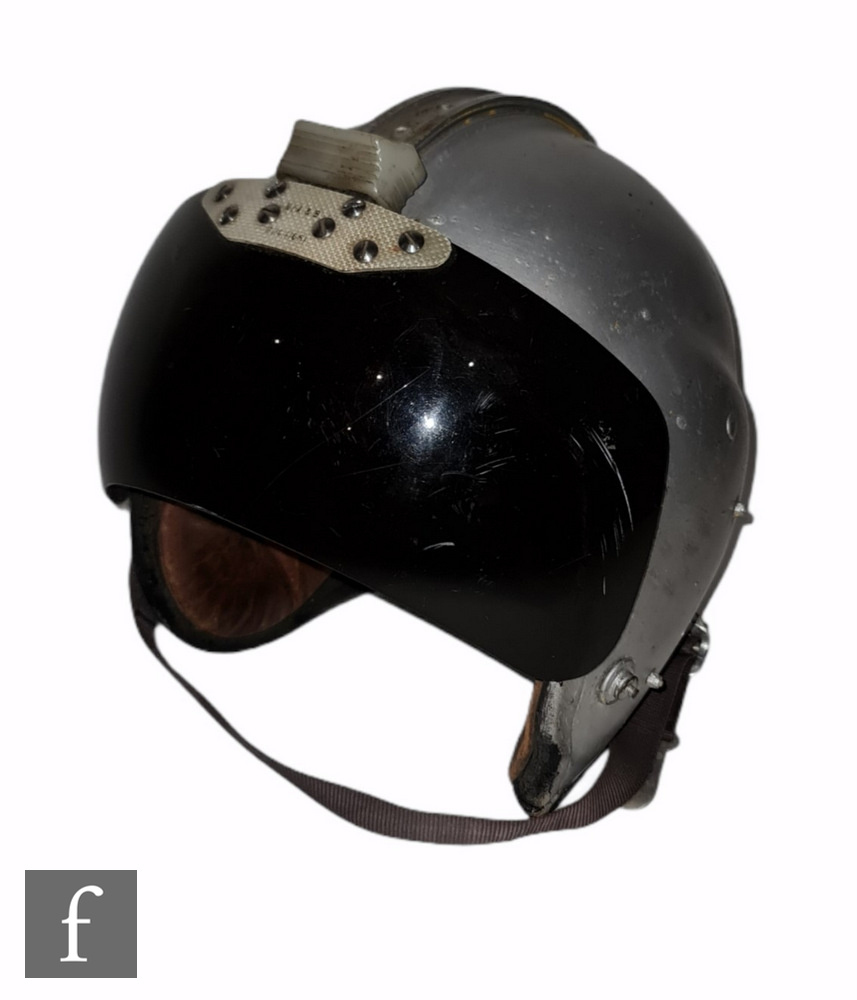 A 1950s pilots flying helmet with visor, later re-painted, stamped Anti blast MK2 medium, together