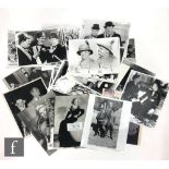 A collection of black and white film and press photographs, mostly reprinted by Pictorial, some with
