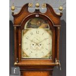 An early 19th Century oak longcase clock with an eight day movement striking on a bell, the case