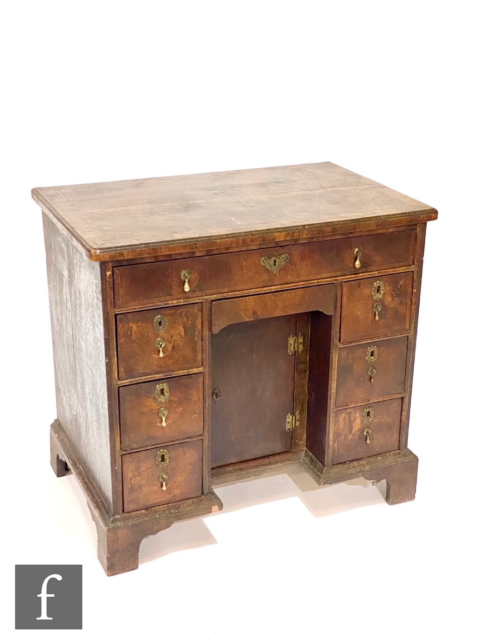 An 18th Century crossbanded and inlaid kneehole writing desk, the quartered and detailed inlaid