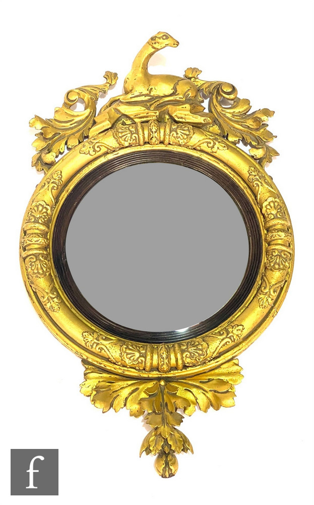 A 19th Century circular gilt wall mirror, the raised frame surmounted with a resting deer flanked by