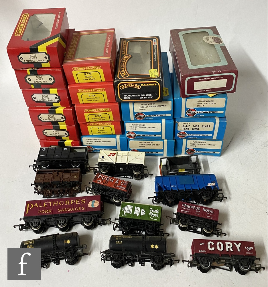 Fifty six OO gauge items of rolling stock by Hornby, Airfix and similar, all playworn, S/D, with a