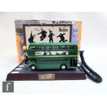 A vintage Beatles collection telephone, the original 1998 Apple licensed novelty telephone in the