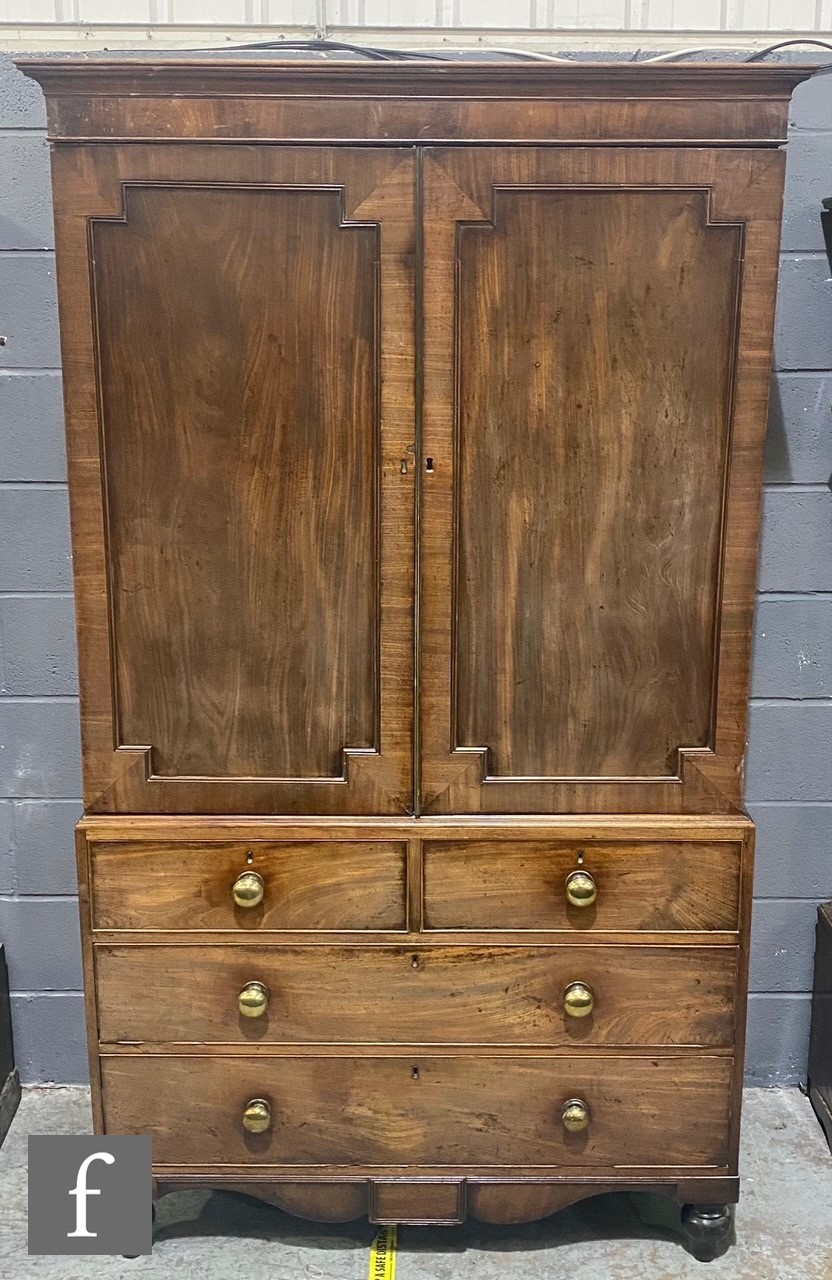 A George III mahogany linen press, the converted hanging space enclosed by a pair of recessed beaded