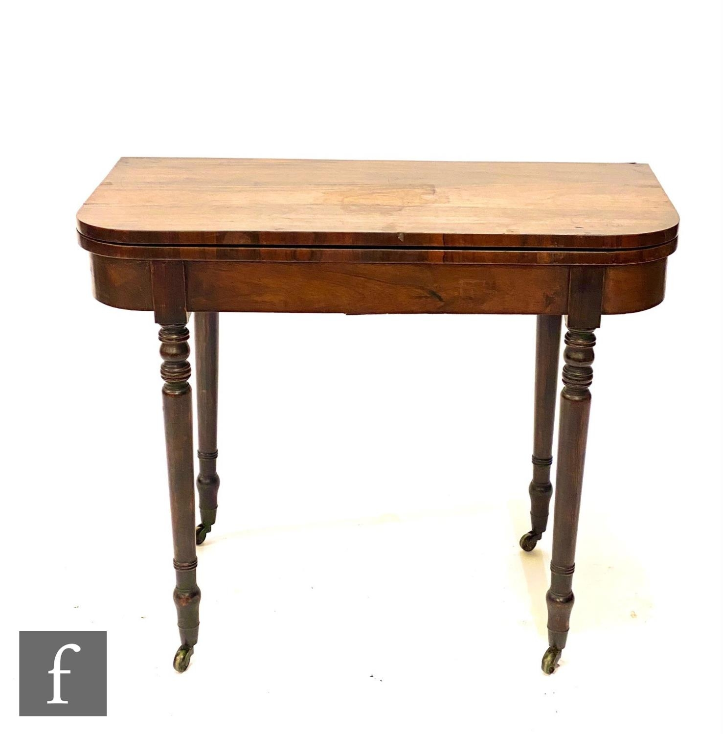 A George IV rosewood D shaped fold over card table, on ring turned legs, 76cm x 91cm.
