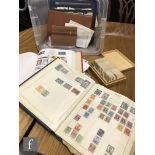 Assorted albums of world stamps, part stock sheets, loose stamps and an album of cigarette cards and