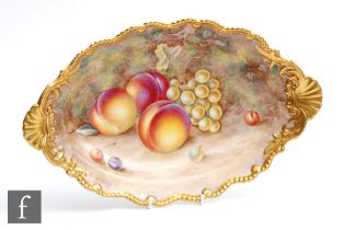 A Royal Worcester Fallen Fruits shaped oval dish decorated by Ayrton with hand painted peaches and