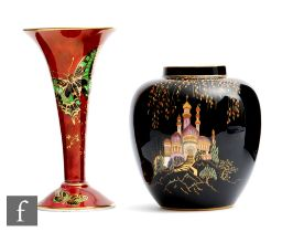 A 1930s Carlton Ware vase decorated in the Sultan and Slave pattern against a black ground,