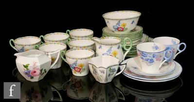 A 1930s Shelley Oxford shape Wild Flowers pattern part teaset comprising six cups, six saucers,