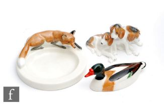 A Royal Worcester Fox pin dish modelled by Doris Lindner, model 2873, S/D, together with a Royal