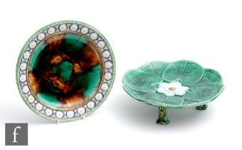 A 19th Century Wedgwood majolica plate with a floral moulded border and tortoiseshell glaze to the