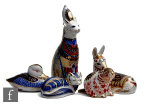 Five assorted Royal Crown Derby paperweights comprising a boxed Royal Cats Egyptian cat (lacking
