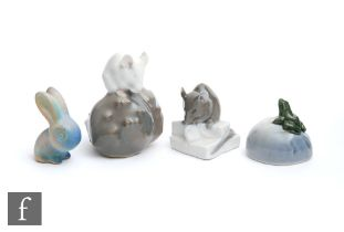 Three small Royal Copenhagen models of animals comprising a white mouse perched on a pebble model