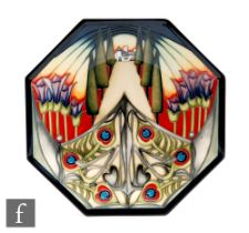 A Moorcroft Pottery octagonal plate decorated in the Eventide House - The Gate pattern designed by