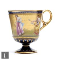 A Vienna type pedestal coffee cup decorated by C. Heer with hand painted classical figures against a
