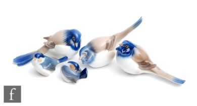 Three Bing and Grondahl models of birds with painted detailing in blue and light brown, comprising