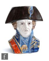 A late 19th to early 20th Century French Faience character jug modelled as Admiral Lord Nelson in