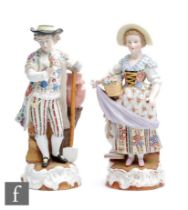 A pair of late 19th to early 20th Century Sitzendorf figures of flower sellers, she holding a basket