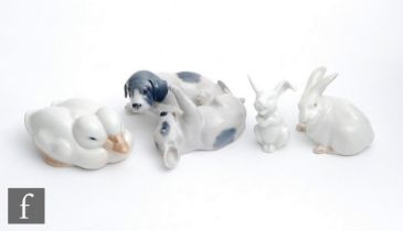 Three Royal Copenhagen model animals comprising two playful puppies, model 453, two huddled ducks,